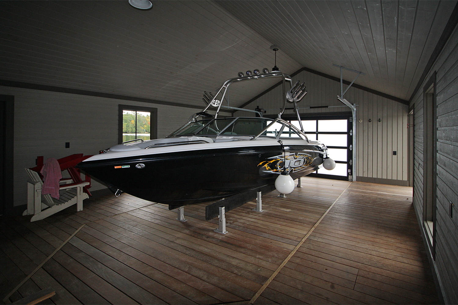 Hidden Beam Wet Slip Lift with decked platform-boathouse by Greenway Construction