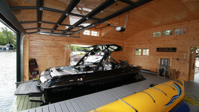Hidden beam wetslip lift with decked platform for malibu ski boat
